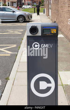 Electric car charging point at Irlam and Cadishead Lesiure Centre, Salford, Greater Manchester, operated by GMEV. - Stock Photo