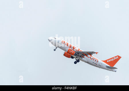 Aircraft -Airbus A319-111-, of -EasyJet Switzerland- airline, is taking off from Madrid-Barajas -Adolfo Suarez- - Stock Photo