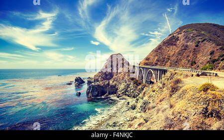 Vintage stylized California coastline along Pacific Coast Highway, USA. - Stock Photo