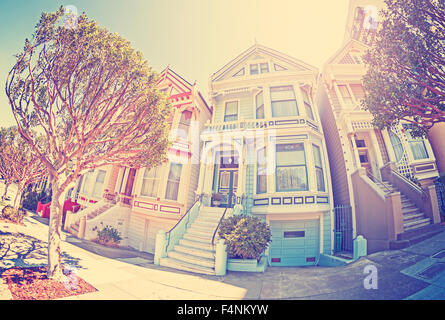 Vintage stylized fisheye lens street photo of the Painted Ladies, San Francisco, USA. - Stock Photo