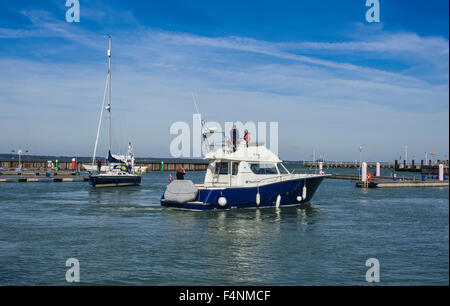 Yarmouth Harbour with Motor Cruiser and Yacht, Isle of Wight, England, UK - Stock Photo
