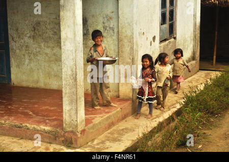 Nagaland, India - March 2012: Group of small happy children in village of Phuktong in Nagaland, remote region in - Stock Photo