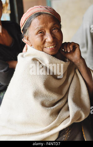 Nagaland, India - March 2012: Happy old woman smiles at camera in Nagaland, remote region of India. Documentary - Stock Photo