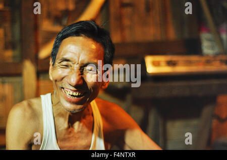 Nagaland, India - March 2012: Unidentified worker laughes in Nagaland, remote region of India. Documentary editorial. - Stock Photo
