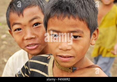 Nagaland, India - March 2012: Small village boys curious about camera in Nagaland, remote region of India. Documentary - Stock Photo