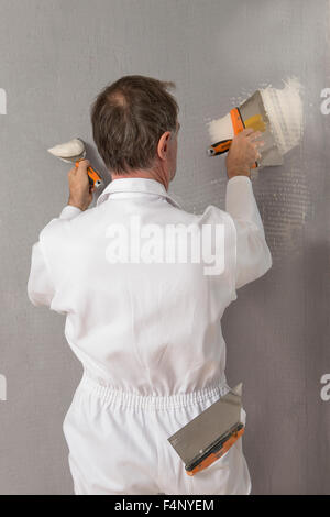 Manual Worker With Wall Plastering Tools Inside A House   Stock Photo