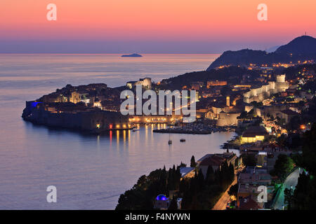 Panoramic view of the Old Town of Dubrovnik, Croatia at dusk - Stock Photo