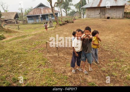 Nagaland, India - March 2012: Group of playful small kids in Nagaland, remote region of India. Documentary editorial. - Stock Photo