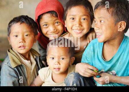 Nagaland, India - March 2012: Group of happy children in Nagaland, remote region of India. Documentary editorial. - Stock Photo