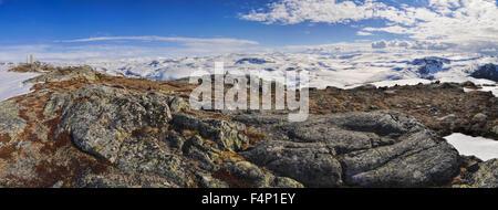 Scenic panorama of snowy landscape near Trolltunga in Norway - Stock Photo