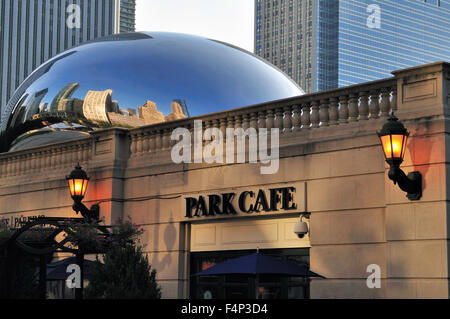 Cloud Gate (also known as The Bean and The Kidney Bean) sculpture sits above the Park Cafe in Chicago's Millennium - Stock Photo