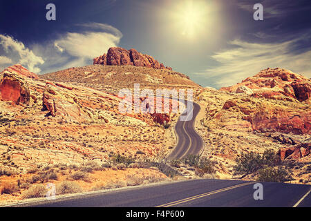 Retro stylized picture of a country road, travel concept, USA. - Stock Photo