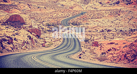 Vintage toned curved desert highway, travel adventure concept, USA. - Stock Photo