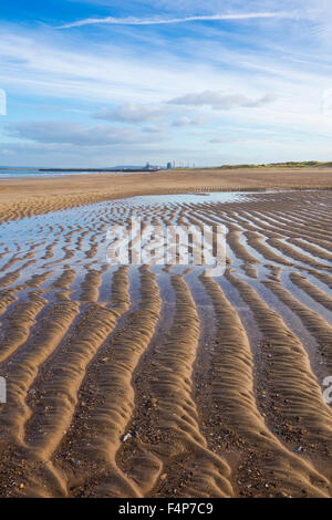 Seaton Carew beach with Redcar steelworks in distance. Seaton Carew, north east England. UK - Stock Photo