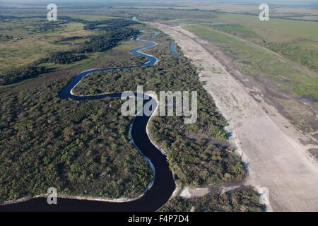 Aerial view of the Kissimmee River as it winds through central Florida eventually joining the Everglades July 7, - Stock Photo