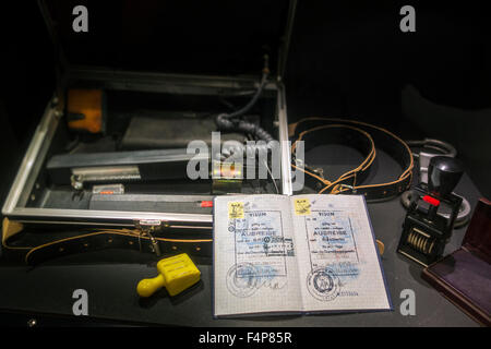 Passport with visas for West-Berlin and FRG and ID check kit including UV control apparatus used by East German - Stock Photo