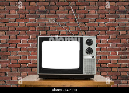 Old Analogue Television With Cut Out Screen And Brick Wall.   Stock Photo