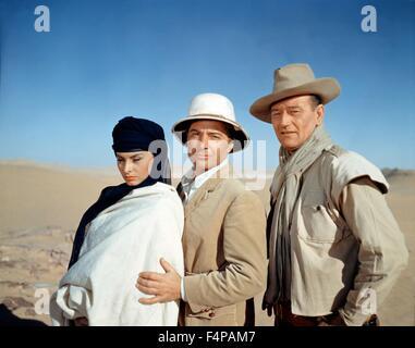 Sophia Loren, Rossano Brazzi, John Wayne / Legend of the Lost 1957 directed by Henry Hathaway - Stock Photo