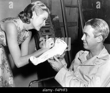 On the set, Grace Kelly and James Stewart / Rear Window / 1954 directed by Alfred Hitchcock [Paramount Pictures] - Stock Photo