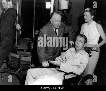 On the set, Wendell Corey, Grace Kelly and James Stewart / Rear Window / 1954 directed by Alfred Hitchcock [Paramount - Stock Photo