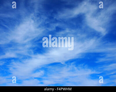 Background of white cirrus clouds in the blue sky - Stock Photo