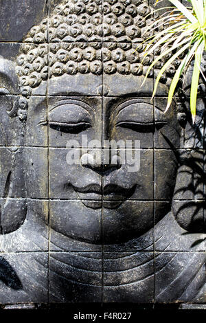 Portrait Carving (Cast) of Buddha's Head Portrait in Bali Indonesia Stock Photo
