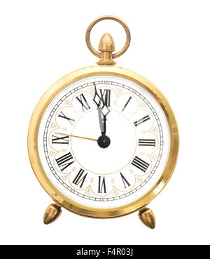 Vintage alarm clock isolated on white background. Five to twelve - Stock Photo