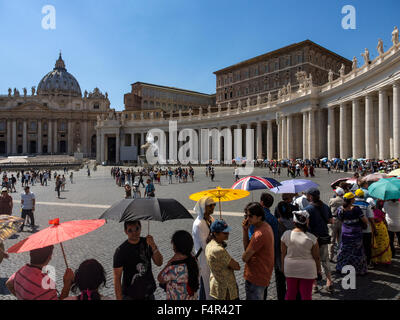 Tourists queuing to get in to St. Peter's Basilica in the Vatican - Stock Photo