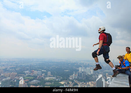 Kuala Lumpur, Malaysia-September 30, 2011: A BASE jumpers in jumps off from Kuala Lumpur Tower. KL Tower BASE Jump - Stock Photo