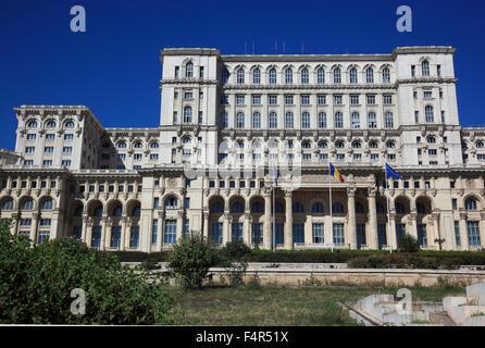 The Palace of the Parliament, Palatul Parlamentului, in Bucharest, Romania is a multi-purpose building containing - Stock Photo