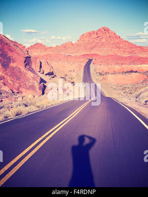 Vintage toned shadow of a photographer in the Valley of Fire, Nevada, USA. - Stock Photo