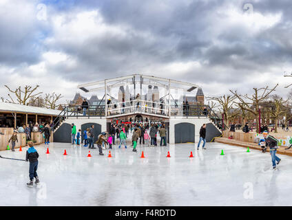Netherlands, Holland, Europe, village, winter, snow, ice, people, skating, skaters, skating rink, Museum square, - Stock Photo