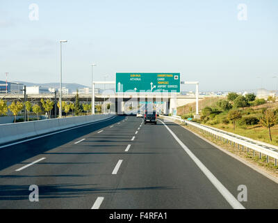 Greek Highway and road sign to Athens - Stock Photo