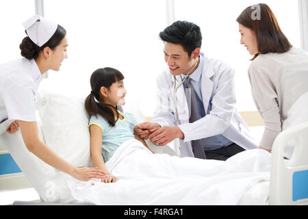 Health care workers and patients in the ward - Stock Photo