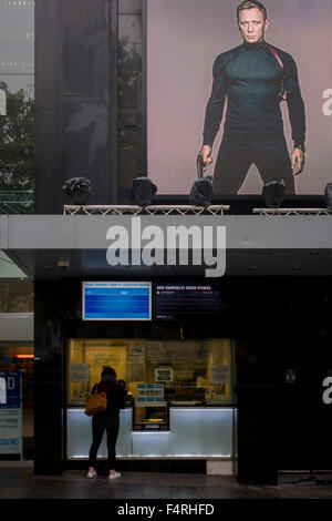 Film ticket office customer with Daniel Craig as James Bond in Leicester Square. - Stock Photo