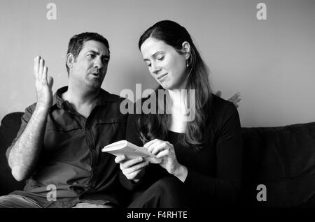 Couple disagree about expectation of life at home. (BW). Spouse relationship concept - Stock Photo