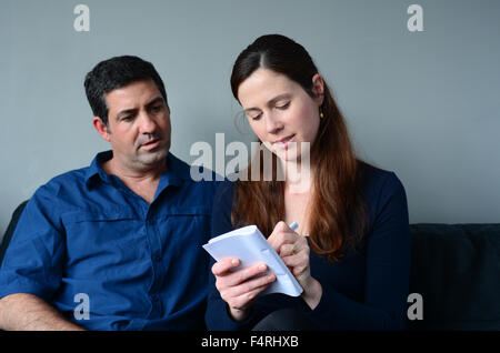 Couple planning their life the living room. Spouse relationship concept - Stock Photo