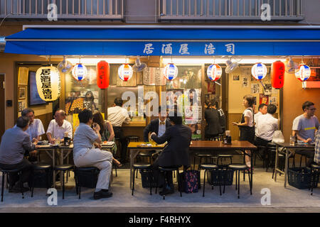 Small outdoor restaurant on street in the evening in Rokku entertainment district of Asakusa adjacent to SensoJi - Stock Photo