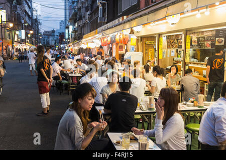 Small outdoor restaurants on street in the evening in Rokku entertainment district of Asakusa adjacent to SensoJi - Stock Photo