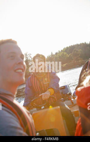 Sweden, Uppland, Stockholm Archipelago, People sailing in bay - Stock Photo