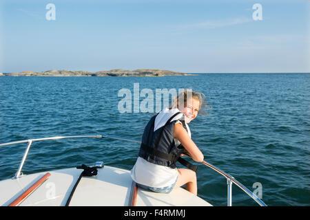 Portrait of girl (12-13) on boat - Stock Photo
