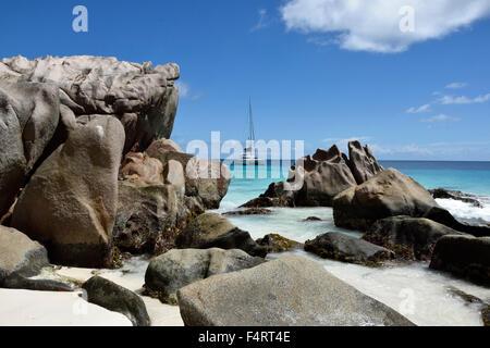 Anse Patatas, boat, granite rock, rock, La Digue, sea, water, Seychelles, Africa, beach, seashore, - Stock Photo
