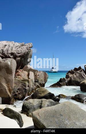 Anse Patatas, boat, granite rock, rock, La Digue, sea, water, Seychelles, Africa, - Stock Photo