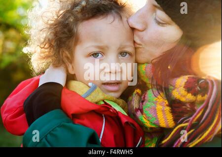 Sweden, Vastra Gotaland, Gothenburg, Mother kissing girl's (2-3) forehead - Stock Photo