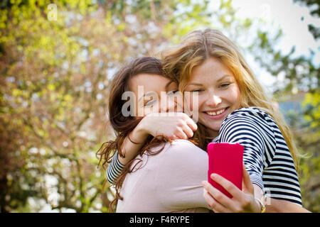 Taking Selfie with Smartphone - Stock Photo