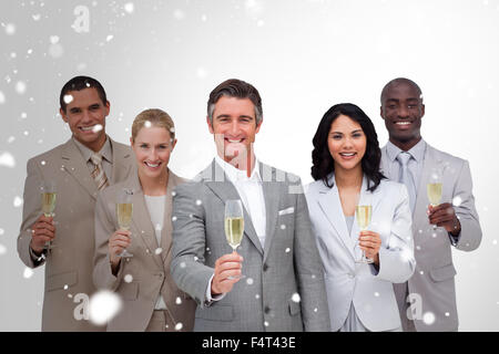 Composite image of business team celebrating a success with champagne - Stock Photo