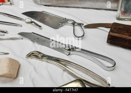 Stainless steel surgical saws and bone snipper - Stock Photo