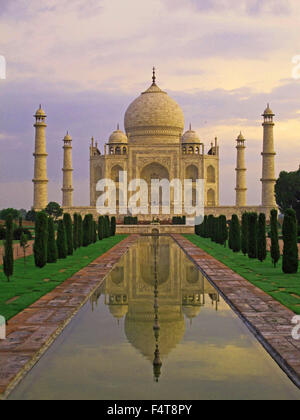 The Taj Mahal at sunrise in India, Agra, White marble dawn breaking - Stock Photo