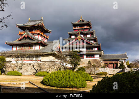Japan, Kyoto, Fushimi Momoyama-jo castle. Yagura, tower, with the main keep, tenshu, in the background. Very dark - Stock Photo