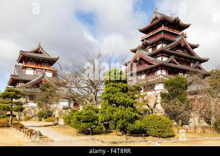 Japan, Kyoto, Fushimi Momoyama-jo castle. The borogata style tenshu, keep, with connecting yagura, turret. Small - Stock Photo